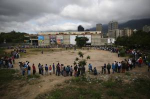 Shoppers line up to buy groceries in Venezuela