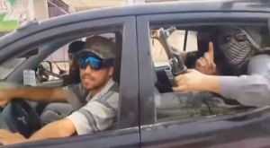 Shahad hand signal by ISIS fighter.