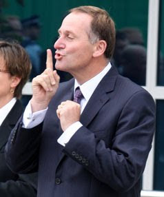 """260310 News Photo: Murray Wilson/ Manawatu Standard.Opening of the  new Levin courthouse .Prime Minister John Key tells the protesters to """"shoosh"""" so he can speak."""