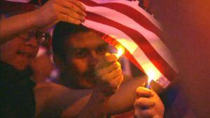 Mexicans burn Trump banner